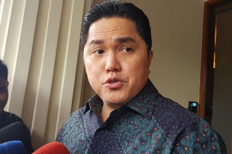 Menteri BUMN Erick Thohir usai laporan kepada Menkopolhukam Mahfud MD di Kantor Kemenkopolhukam, Jalan Medan Merdeka Utara, Jakarta Pusat, Kamis (5/12/2019).