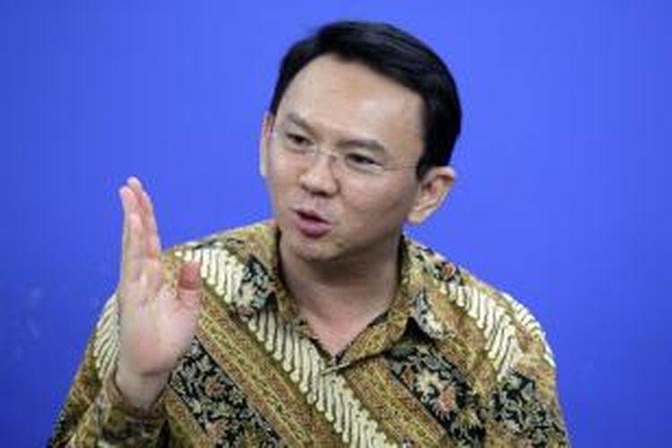 Wakil Gubernur DKI Jakarta Basuki Tjahaja Purnama memberikan penjelasan saat berkunjung ke kantor redaksi Kompas.com di Palmerah, Jakarta Barat, Rabu (15/1/2014).