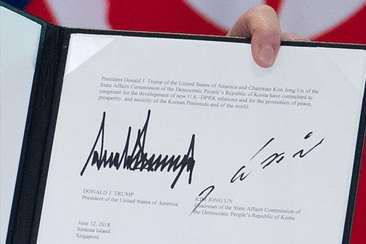 Tanda Tangan Donald Trump dan Kim Jong Un