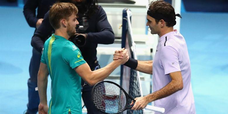 david Goffin (kiri) dan Roger Federer (kanan)