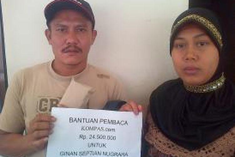 Orangtua bayi kembar parasit, Aep Supriatna dan Yani Mulyani menerima bantuan pembaca kompas.com sebesar Rp. 24.500.000