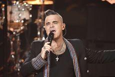 Yakin Terinfeksi Virus Corona, Robbie Williams Sewa Airbnb
