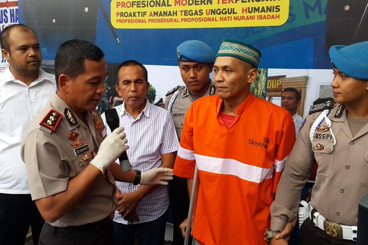 Kapolres Malang Kota, AKBP Leonardus Simarmata saat merilis satu dari empat tahanan narkoba yang kabur, Selasa (10/12/2019).