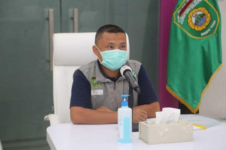 Juru Bicara Gugus Tugas Penanganan Covid-19 Sumatera Selatan Yusri saat menyampaikan perkembangan penyebaran virus corona.