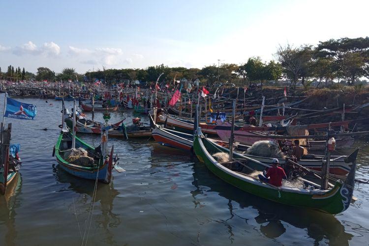 Sejumlah kapal nelayan bersandar di Pelabuhan Muncar, Banyuwangi, Jawa Timur, Minggu (6/6/2021)
