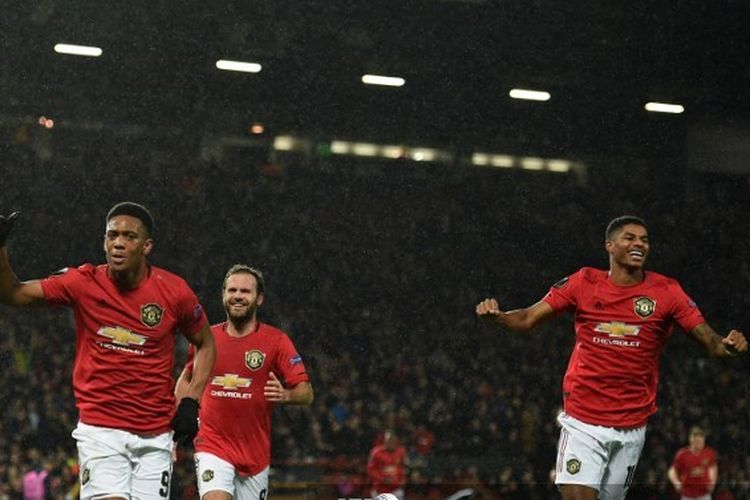 Manchester Uniteds French striker Anthony Martial (2nd L) runs to celebrate scoring their second goal during the UEFA Europa League Group L football match between Manchester United and Partizan Belgrade at Old Trafford in Manchester, north west England, on November 7, 2019.