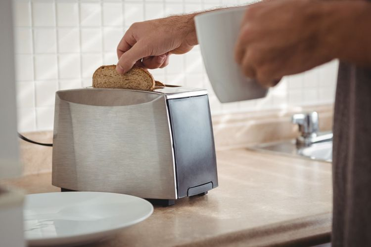Ilustrasi pemanggang roti atau toaster.