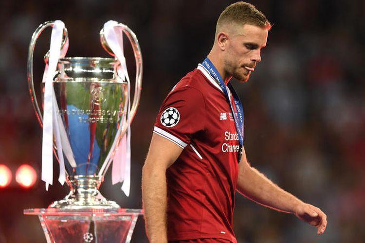 Kapten Liverpool, Jordan Henderson melewati piala Liga Champions seusai timnya kalah 1-3 dari Real Madrid di partai final, Sabtu (26/5/2018). Liverpool vs PSG akan menjadi langkah awal Henderson di Liga Champion musim ini.