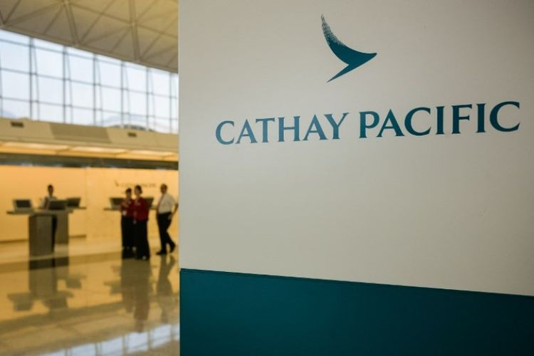 Ilustrasi Cathay Pacific. (AFP/ANTHONY WALLACE)