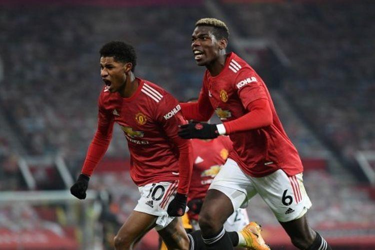Marcus Rashford berselebrasi bersama Paul Pogba usai mencetak gol pada laga lanjutan pekan ke-16 Liga Inggris 2020-2021, Manchester United vs Wolverhampton Wanderers, di Stadion Old Trafford, Selasa (29/12/2020) atau Rabu dini hari WIB.