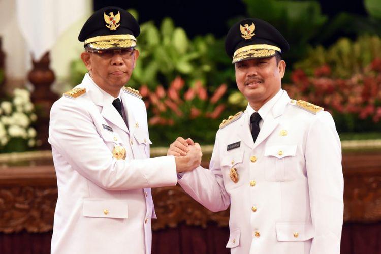 Gubernur Kalbar Sutarmidji (kiri) dan Wakil Gubernur Kalbar Ria Norsan (kanan) seusai dilantik oleh Presiden Joko Widodo di Istana Negara (5/9/2018).