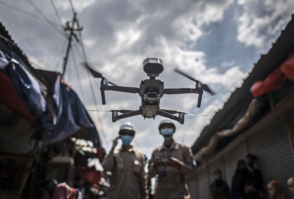 PENGUKURAN SUHU TUBUH MENGGUNAKAN DRONE